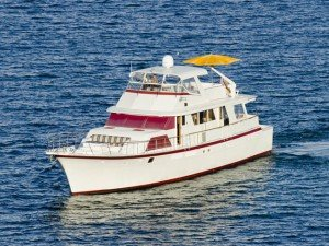 Obsession is a 85 ft Hatteras motor yacht available for fully crewed rental for the perfect BVI and Caribbean sailing vacation.