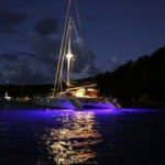 Caribbean catamaran Lolita showing off its underwater night lights