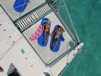 sunbathe during chartered bvi yacht cruise
